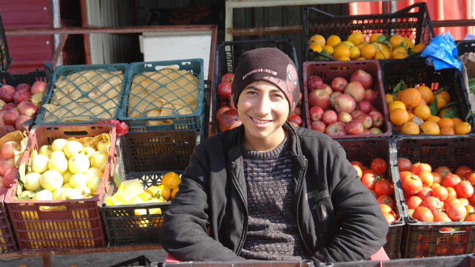 Renas, an IDP student, affords his family expenses from a grocery store
