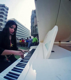 Rana Jassim teaches piano to Kids with Down syndrome