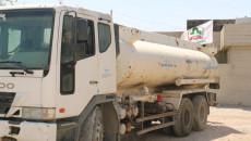 عصائب اهل الحق توزع المياه الصالحة للشرب بحوضيات حكومية على المواطنين في كركوك