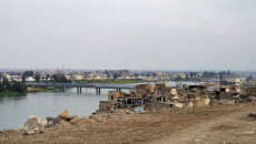 Woman jumps off Mosul's Old Bridge in apparent suicide