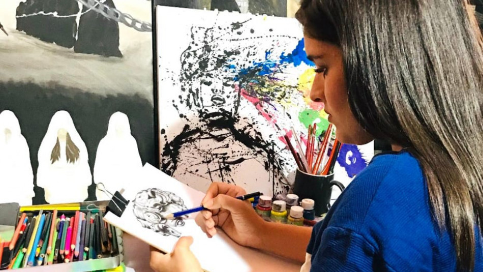 Displaced Ezidi girl paints her feelings and imaginations during coronavirus lockdown