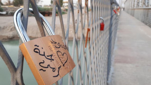 An old bridge in Mosul embraces a new tradition for lovers